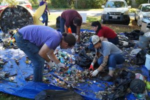 volunteers sorting trash at the Fort River Cleanup 2019